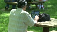 Stock Video Footage of Man on his tablet outdoors (1 of 1)