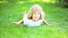 Child lying outdoors in spring Stock Footage