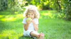 Child eating apple Stock Footage