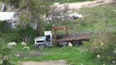 Abandoned old truck in poor neighborhood Stock Footage
