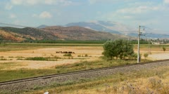 A passenger train travels across a generic landscape in Europe, Russia or - stock footage