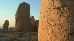 Tourists take photos of the great archeological ruins on the top of Mt. Nemrut, Stock Footage