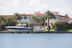 Luxurious waterfront property with a boat - stock photo
