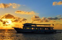 Boat at Sunrise Stock Photos