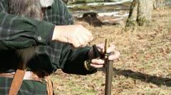 Man with Black Powder Gun Filling, Step 1 Stock Footage