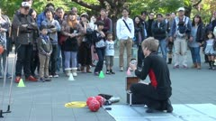 Street performer juggling in front of impressed crowd in Tokyo, Japan Stock Footage