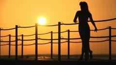 Girl runs on pier Stock Footage