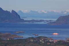 ferry leaving svolvaer on lofoten - stock photo