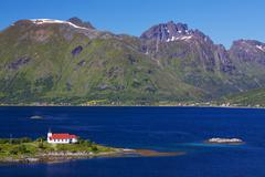 picturesque church on lofoten - stock photo