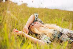 beautiful young woman enjoying day outside - stock photo