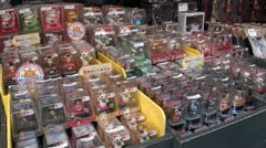 Beckoning cats and other dolls for sale at a tourist market in Tokyo, Japan Stock Footage
