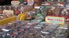Beckoning cats, pandas, geishas, and other puppets at a tourist market in Tokyo Stock Footage