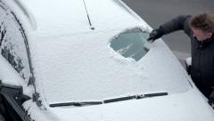 scraping the ice of a car windshield in 1080p - stock footage