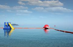 water slide seascape summer vacation scene - stock photo
