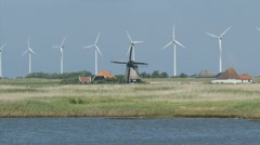 Wind turbines behind a traditional Dutch windmill Stock Footage