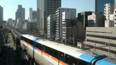 Monorail and commuter trains ride through central Tokyo, Japan - stock footage