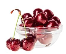 Still life with pair of red wet cherry fruit on stem and glass bowl, isolated Stock Photos
