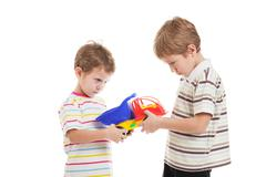 children in conflict fight for toy - stock photo