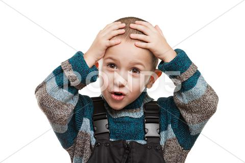 Stock photo of amazed or surprised child boy