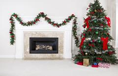 Gas insert fireplace in use during holidays Stock Photos