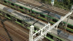 Two trains passing on tracks, railways, transportation, Tokyo, Japan Stock Footage