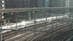 Reflection of a high speed bullet train riding through Tokyo in Japan Stock Footage