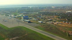 Stock Video Footage of Small airport aerial view. Airport runaway. Aerial view above airport terminal