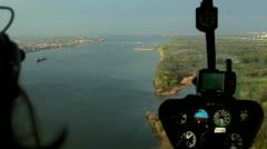 Aerial view from helicopter. Helicopter flying above river. River aerial view - stock footage
