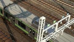Commuter train, overhead video, public transport, Tokyo, Japan Stock Footage