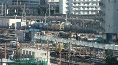 Train tracks, city skyline, Shinagawa station, zoom out, Tokyo, Japan Stock Footage