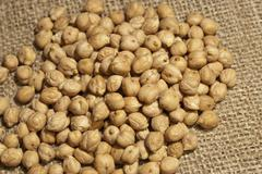 Chickpeas on natural fabric Stock Photos