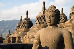Buggha statue and stupas in borobudur temple, indonesia Stock Photos