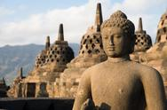 Stock Photo of buggha statue and stupas in borobudur temple, indonesia