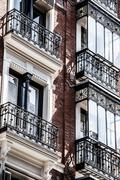 mediterranean architecture in spain. old apartment building in madrid. - stock photo