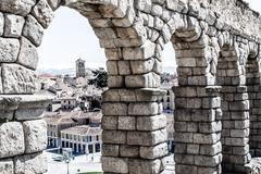the famous ancient aqueduct in segovia, castilla y leon, spain - stock photo
