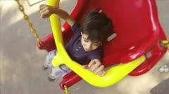 Hispanic Kid on Swing at Public Park Stock Footage