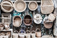 wooden baskets and caskets on sale in street - stock photo