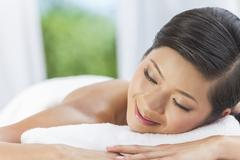 happy asian chinese woman relaxing health spa - stock photo