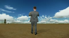 Businessman with Map in Desert with Time Lapse Clouds, back view Stock Footage
