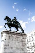 Stock Photo of the monument of charles iii on puerta del sol in madrid, spain