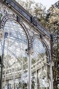 madrid palacio de cristal in retiro park glass crystal palace spain - stock photo