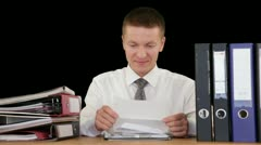 Young Businessman getting fired through a letter, against black - stock footage