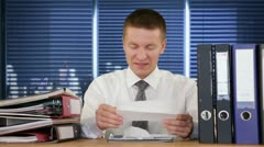 Businessman getting fired through a letter - stock footage