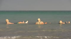 Floating with mud dead sea nature spa Stock Footage