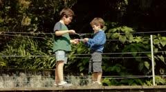 Hispanic Kids Blow Bubbles At Bridge - stock footage