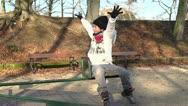 Young boy leaves joyfully carousel Stock Footage