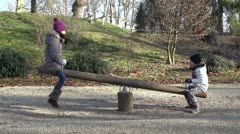 Children on the seesaw - slow motion Stock Footage