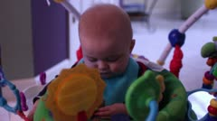 6 month male caucasian baby playing with toys and teething Stock Footage
