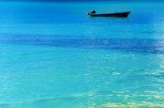 Blue Boat, Blue Water - stock photo