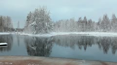 View of unfrozen lake in Karelian evergreen forests Stock Footage